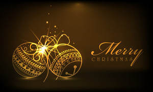 Beautiful shiny Xmas ball in golden color on brown background for Merry Christmas celebrations.