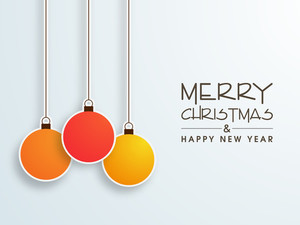 Colorful hanging Xmas ball for Merry Christmas and Happy New Year celebration on stylish background.