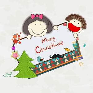 Little cute kids holding Merry Christmas celebration board on beige background.