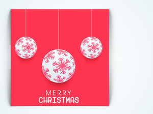 Christmas Day celebration with hanging ball decorated with snowflake and stylish text of Merry Christmas on red background.