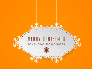 Christmas Day celebration with hanging text of Merry Christmas and Love and Happiness on bright orange background.