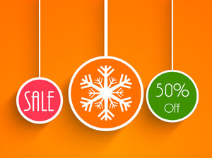 Christmas Day sale with 50% off on bright orange background.