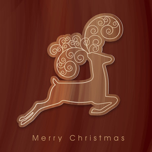 Stylish brown reindeer on wooden background for Merry Christmas celebrations.