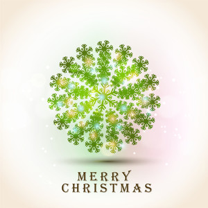 Shiny Xmas Ball made by snowflake for Merry Christmas celebration on colorful shiny background.