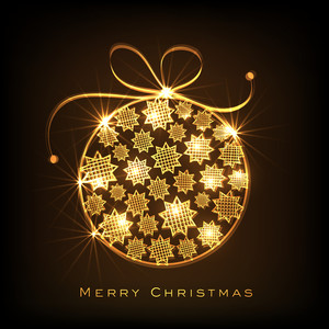 Shiny golden Xmas Ball decorated by stars for Merry Christmas celebration on brown background.