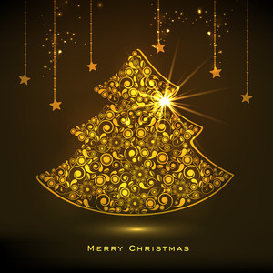 Beautiful floral design decorated golden X-mas Tree and stars on shiny brown background for Merry Christmas celebrations.