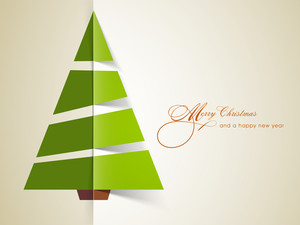 Origami green christmas tree for Merry Christmas and Happy New Year celebrations.