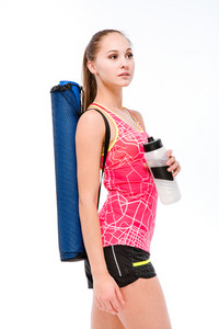 Sports woman with yoga mat and shaker