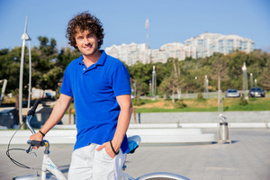 Happy man with bicycle at the city