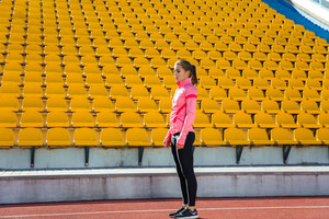 Sports woman standing at stadium