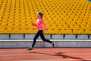 Woman running at the stadium
