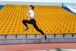 Woman running at stadium