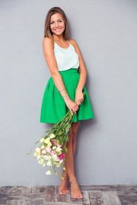 Pretty girl holding bouquet with flowers