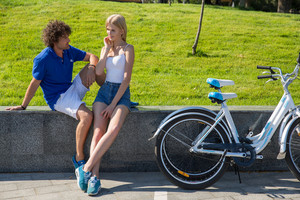 Couple resting after riding on bicycle