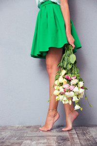 Female legs and flowers