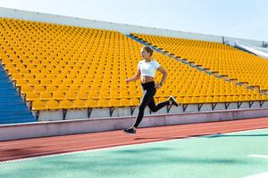 Woman running on stadium