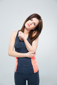 Sports woman having pain in elbow