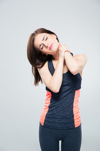 Sporty young woman with neck pain