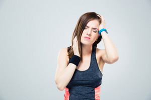 Sports woman having headache