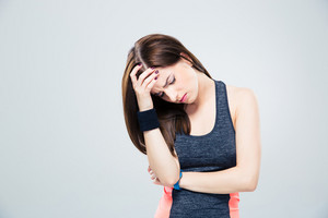 Fitness woman having headache