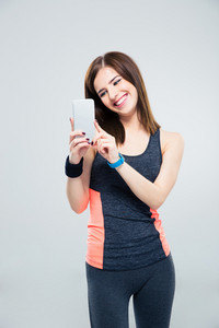 Fitness woman using smartphone