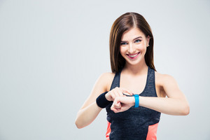 Smiling woman using activity tracker