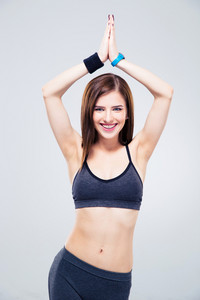 Happy sporty woman making yoga exercises