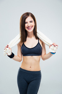 Smiling sporty woman with towel