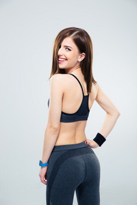 Back view portrait of a smiling sporty woman