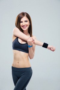 Happy sporty woman stretching hands