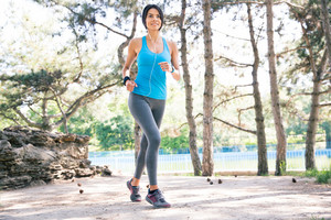 Happy fitness woman running outdoors