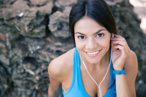 Portrait of a sporty woman with headphones