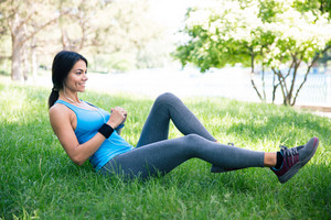 Sporty woman doing stretching exercsises in park