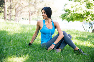 Beautiful woman stretching exercises on the grass