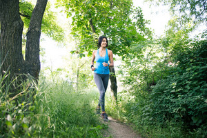 Smiling sporty woman running outdoors