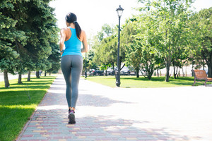 Sports woman running outdoors