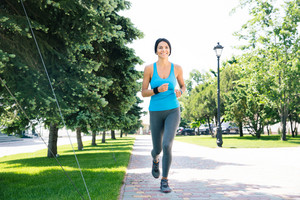 Happy sports woman running outdoors
