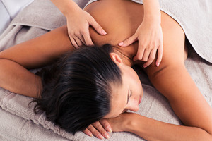 Masseur doing massage on woman body