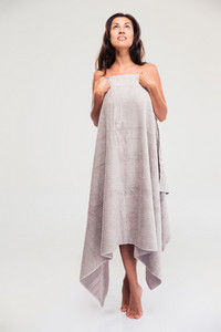 Thoughtful woman standing in towel