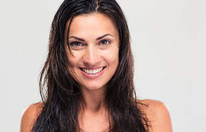 Portrait of a smiling woman with wet hair