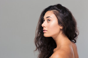 Beauty portrait of attractive woman looking away