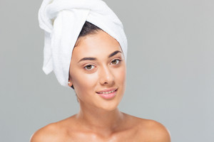 Woman with towel on head looking at camera