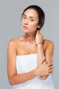 Portrait of a young woman standing in towel