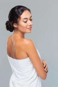 Portrait of attractive woman in towel looking away