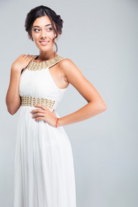 Portrait of a smiling pretty woman in white dress