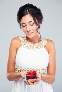 Woman holding jewelry gift box