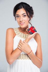 Cute woman holding jewelry gift box