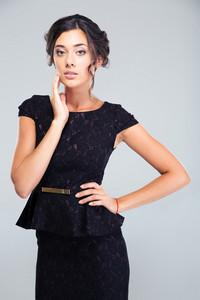 Portrait of a charming woman in black dress