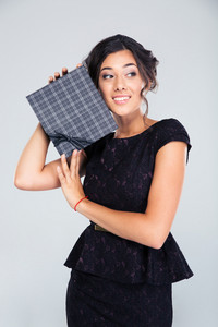 Smiling fashion woman holding gift box