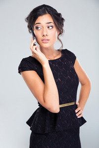 Woman in black dress talking on the phone